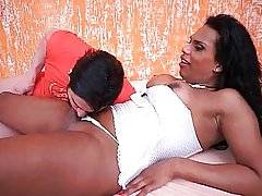 Chocolate tranny gets her dick sucked by her horny friend.